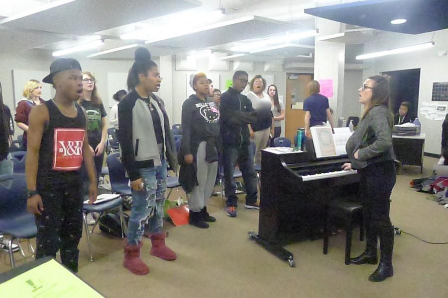 Concert+Choir+students+participate+in+daily+warm+ups+led+by+director+Kristine+Gage.+