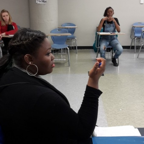Shaquana Williams leads discussion in the Social Justice Organization about the Department of Justice Report. The group meets once a week after school.