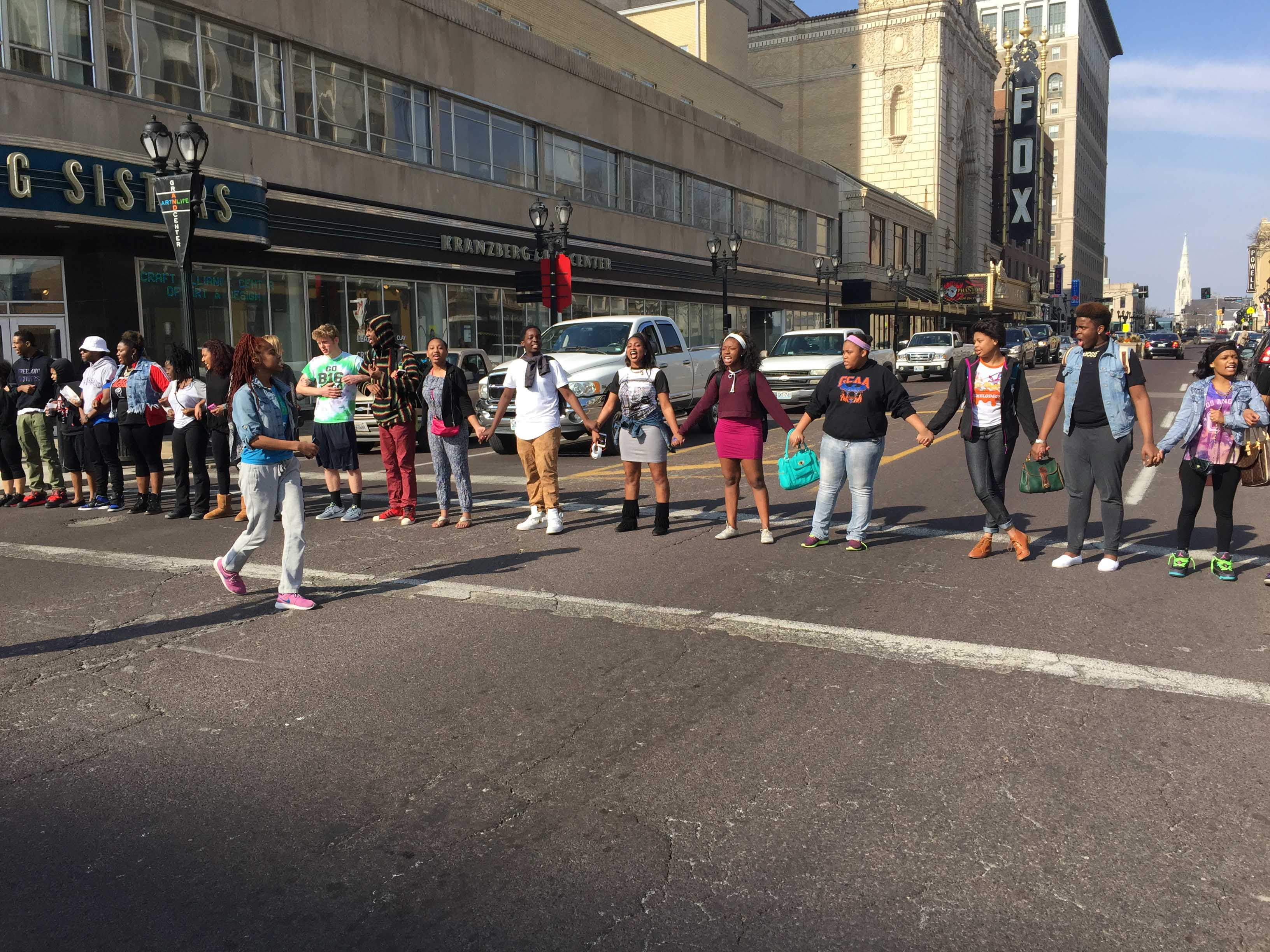 Students protest while blocking Grand on March 12th after the Department of Justice report came out on the Michael Brown case. The protest was to maintain awareness of the Ferguson crisis.