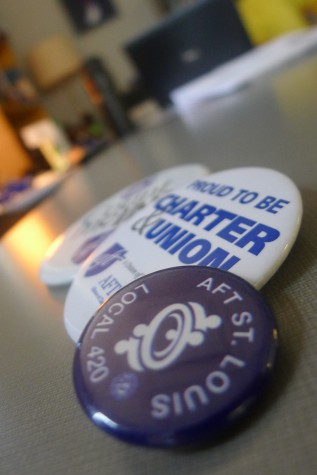 A Sept. 10, 2015 file photo of three buttons that support the union. The buttons say things such as, 'Count me in!' and 'Proud to be Charter & Union'. AFT St. Louis, Local 420 is the American Federation of Teachers in St. Louis.