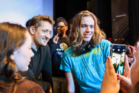 Hunter Holtzman (right) posing for a picture with Alex Winter (center left)
