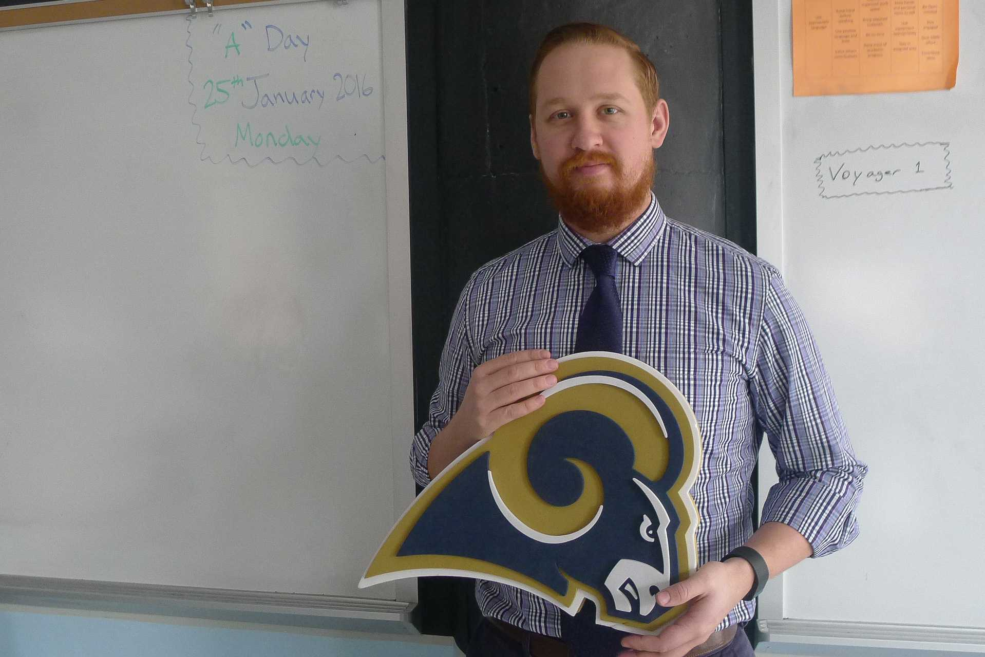 Michael Mancuso, Algebra 1B and 2 instructor, holds Rams' logo in hands. Mancuso tells about his 25 years of experience in St. Louis, and how he is somewhat saddened about the transfer of the Rams.