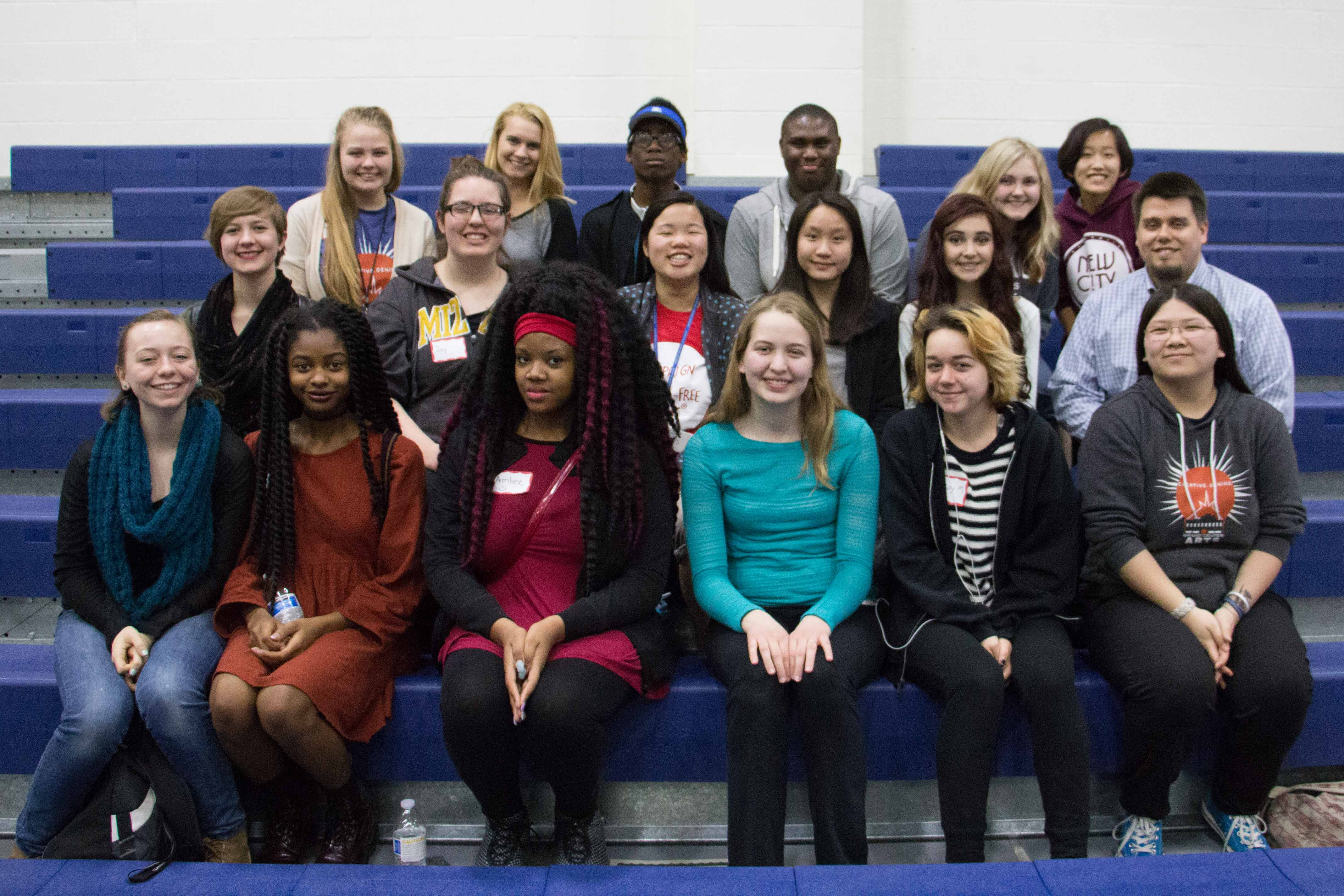 GCAA Student Media, and adviser Travis Armknecht, sit in the bleachers in the Webster University gymnasium. Students attended multiple workshops throughout the day to enrich their skills in journalism.