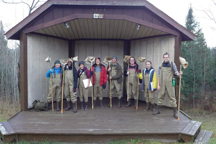 The+APES+Class+are+dressed+in+waders%2C+ready+for+stream+ecology%2C+catching+bugs+in+streams+as+apart+of+one+of+their+daily+lessons.+The+nets+are+used+to+sift+through+sand+and+more+dense+surfaces+to+find+the+bugs.+The+thing+the+class+is+standing+on.+Mr.+Warren+originally+had+that+as+his+desktop+wallpaper+on+his+laptop%2C+which+was+the+reason+behind+the+class+going+to+Wisconsin+in+the+first+place.%0A