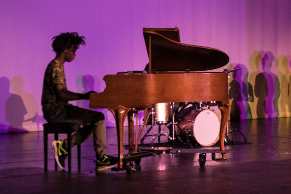 Sophomore Royce Martin plays piano with Jazz Band for the Black History Month performance. Their repertoire consisted of