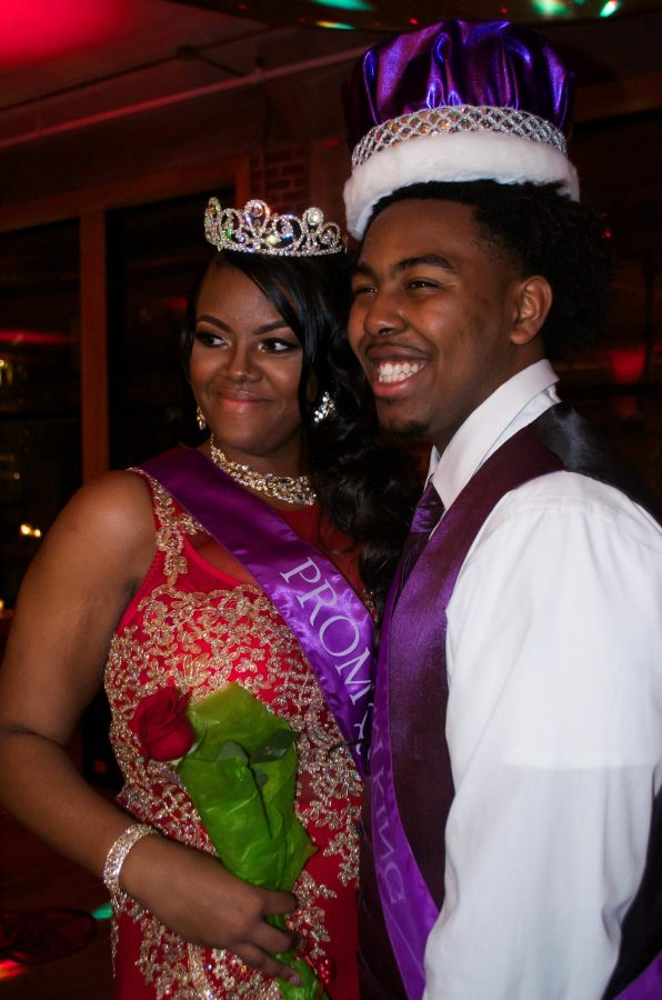 Seniors+Amber+Frost+and+Carrington+Barnes+smile+for+a+picture+after+being+crowned+prom+queen+and+king.+