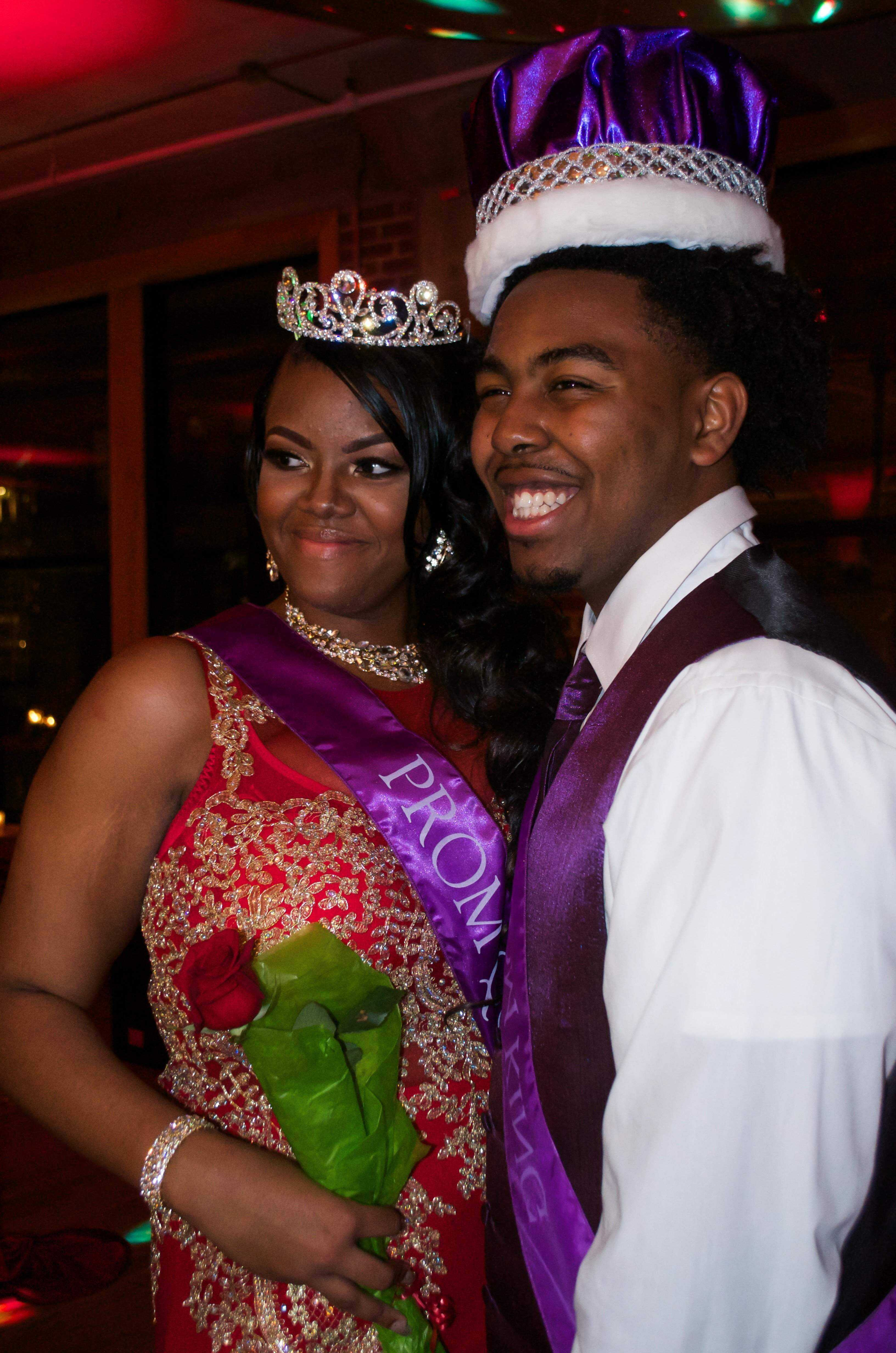 Seniors Amber Frost and Carrington Barnes smile for a picture after being crowned prom queen and king.