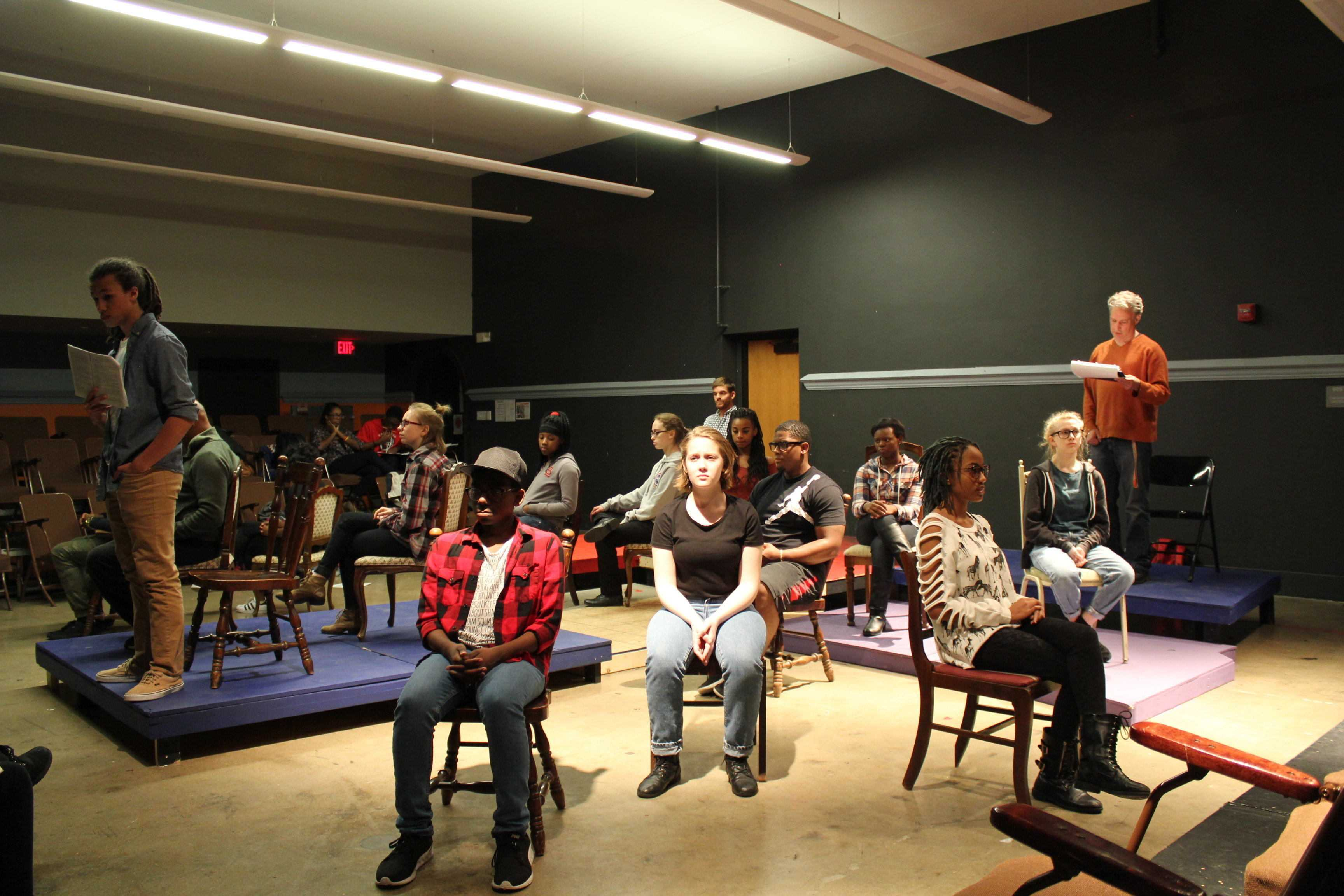 The cast rehearses a scene from the final act of The Laramie Project.