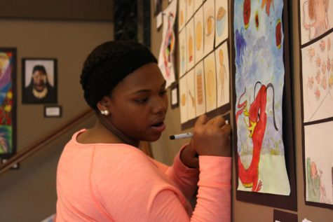 Kalleigh Matthews, 8th grade, signs collage project of butterscotch candy.  The project was about taking an everyday object and imagining 14 different ways it could look.