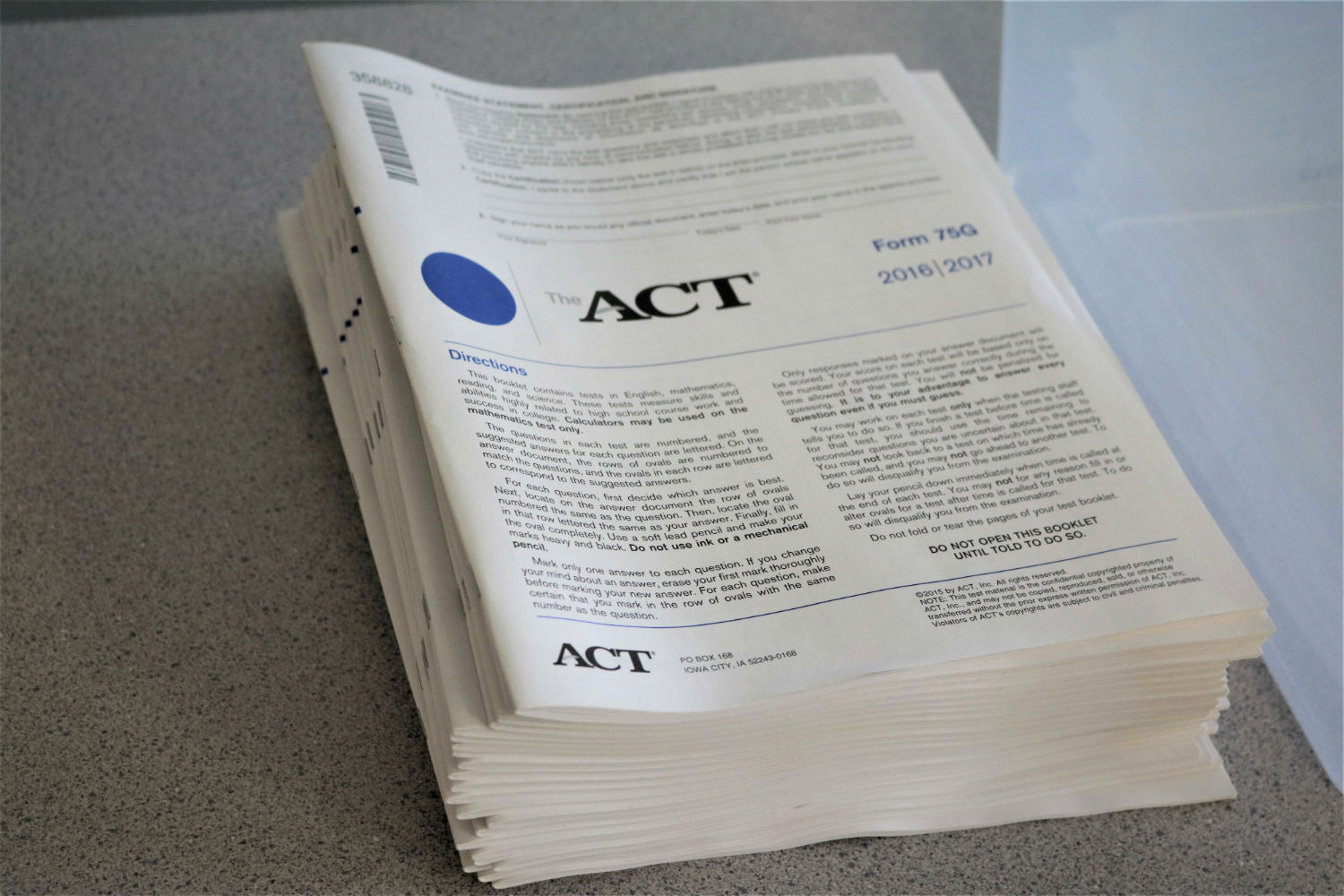 A+stack+of+ACT+test+materials+stacked+on+a+proctors+desk%2C+moments+before+students+began+testing+on+April+19th.
