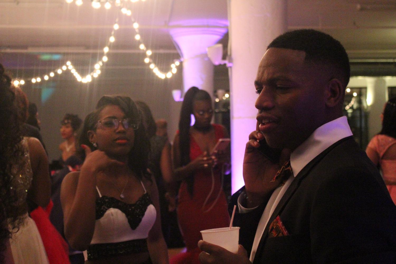 Junior Nadeya McMiller and senior Oscar Nshimirimana dance. McMiller jokingly mocks Nshimirimana as he is on the phone.