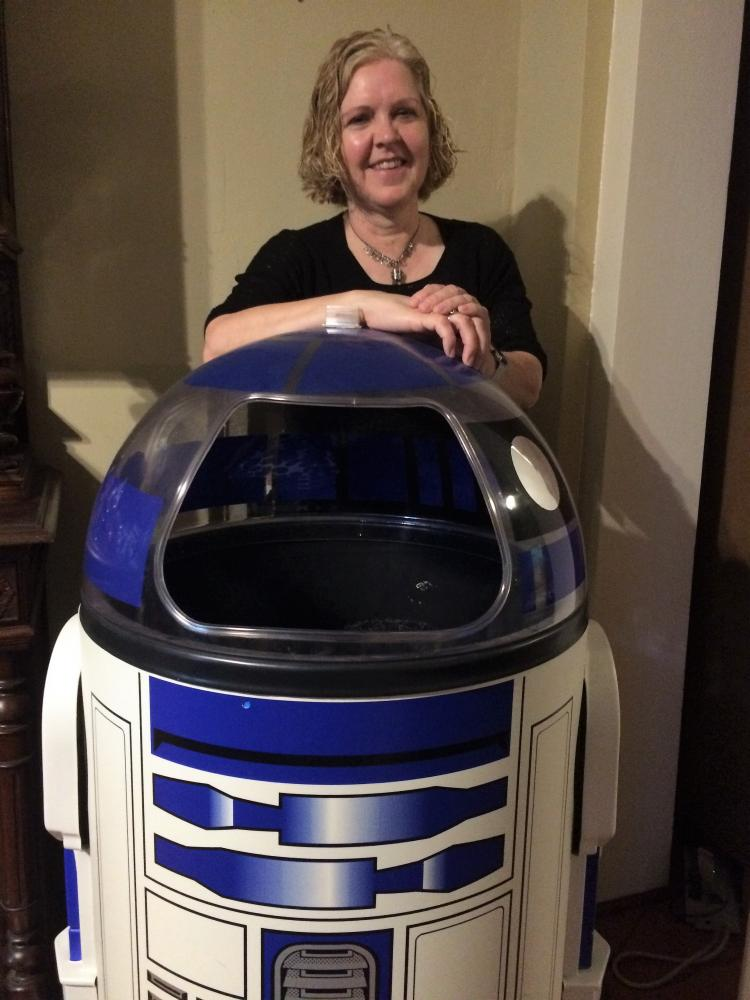 Christine Nobbe, Instructional Coach, poses with a piece from her R2D2 collection.