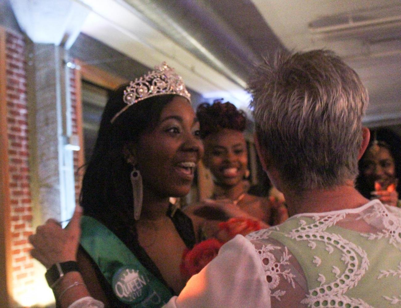 Dejah Farmer, senior, and Lisa Kaczmarczyk, high school principal, just after Farmer was announced Prom Queen.