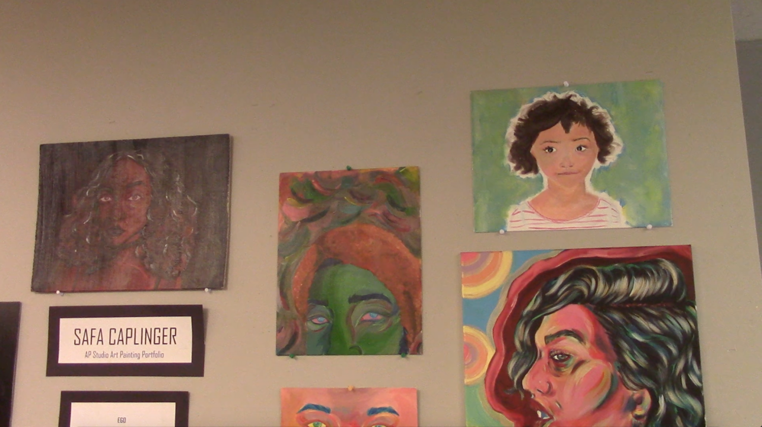 Safa Caplinger created the painted portraits seen in the Sun during the art show on Thursday, April 20th, and then on display in the school lobby.