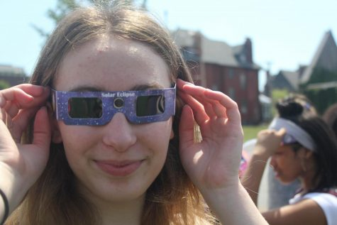 Amirah Bauder puts on her glasses to watch the eclipse.  Bauder says her favorite part was how it was dark even though it was in the afternoon.