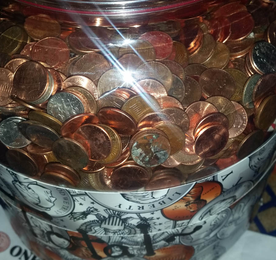 The money jar containing the total amount donated at the end of the Penny War