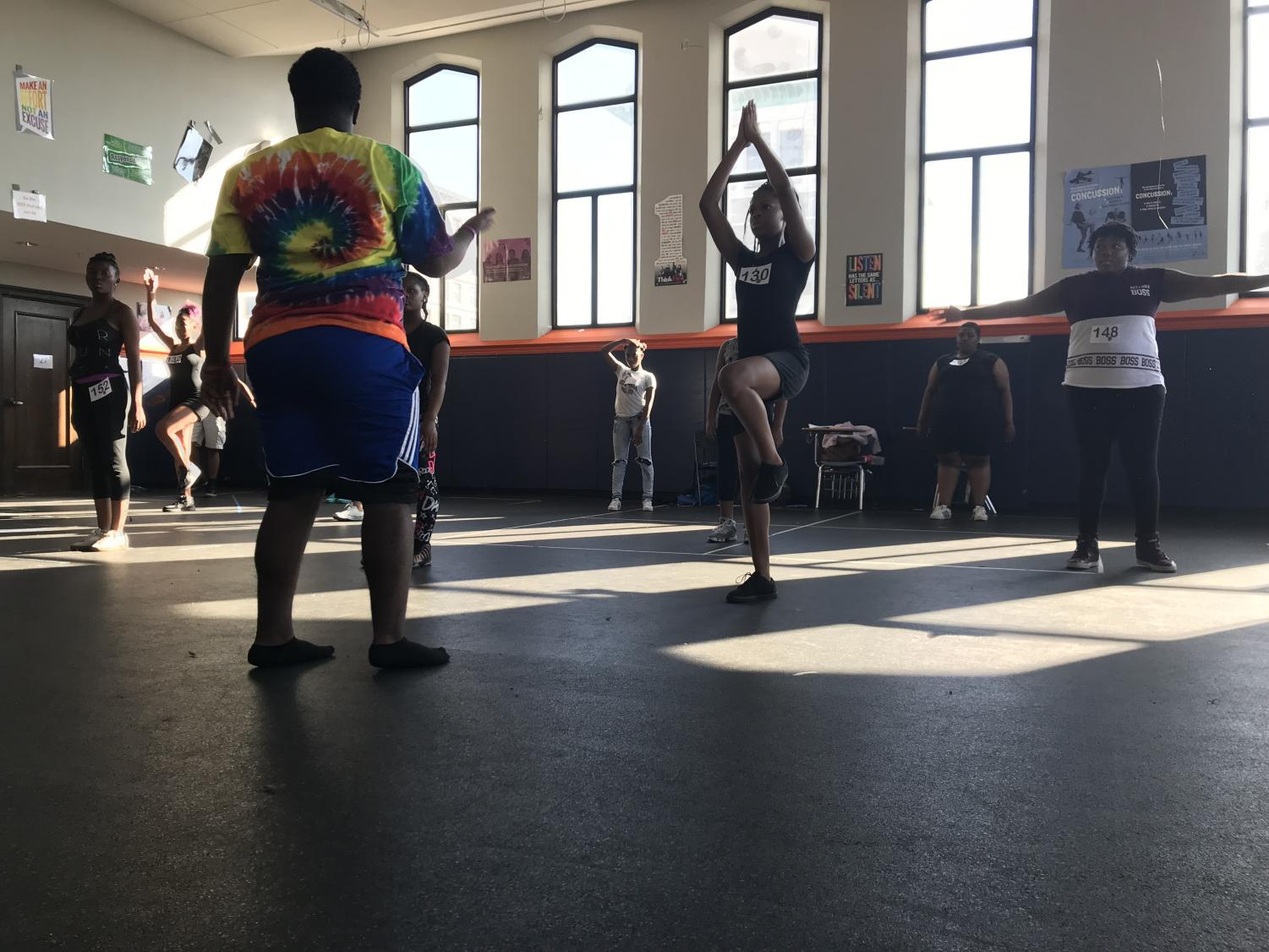 Nate Branch, The Phoenix Elites Captain and creator, teaching a step combination to auditioning students on the sixth floor.