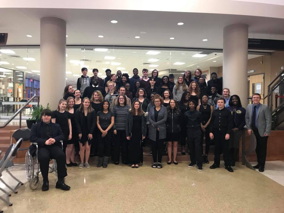 Festival Choir poses for a picture with Wes Smith, vocal music instructor. Festival Choir, Camerata, and Advanced Treble Choir all received ones for their performance.