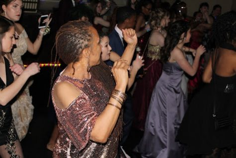 Gina Bell-Moore dance with students during prom.