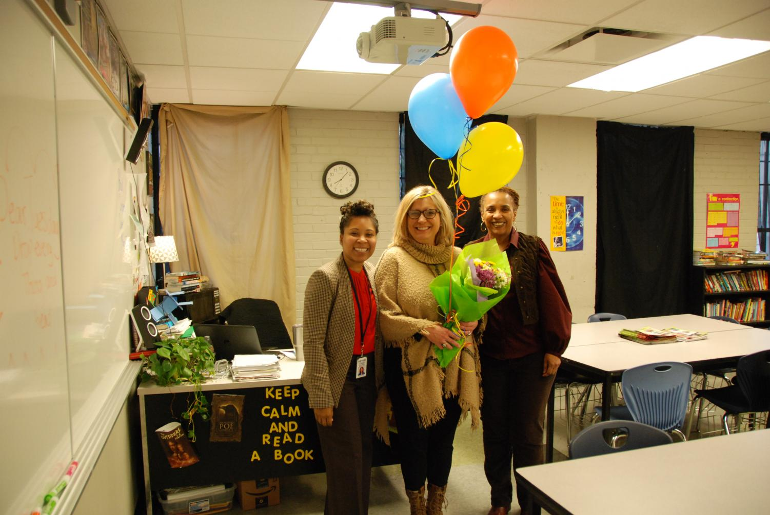 Denise Pranger, Middle School English teacher, poses with Dr. Candice Carter-Oliver, CEO of Confluence Charter Schools, and Gina Bell-Moore,  GCAA Upper Academy Principal, after being surprised with her award.