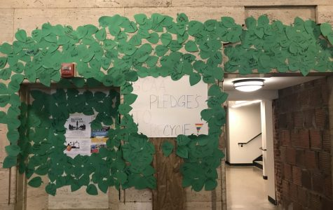 A decorative tree outside the cafeteria, made of signed pledges to recycle by students of GCAA.