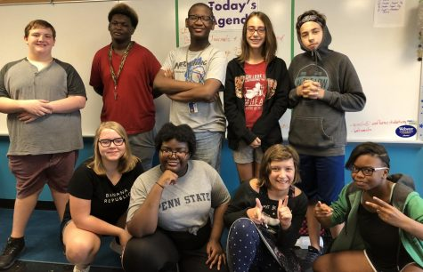 Student council members pause a morning meeting for a photo. (Back row from left to right) Sam Meyer, Timothy Pitts, Katherine Bittle, Jie Crusoe, and Colin Schuessler. (Front row from left to right) Nola Kelley, Baelana Hendrix,  Anna Landgraf, and Dylan Miller.