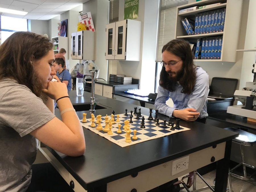 Lillian Selligman (left) and Chris Corriveau (right) play chess together in advisory.