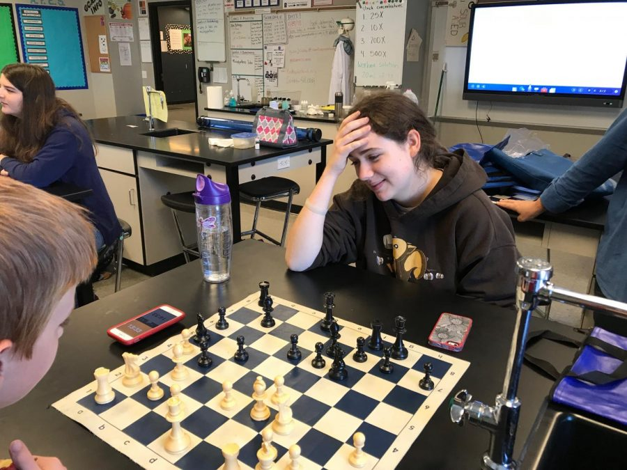 Lillian Selligman (right) contemplates her next move as she plays against Joseph Miller (left).