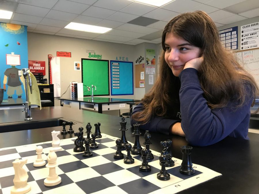 Molly Moen waits for her opponent to make a move.