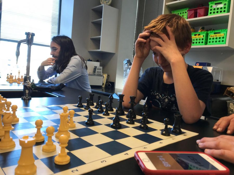 Joseph Miller thinks of his next move in chess.