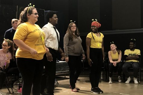 Senior Aurora Philips, theater teacher Brandon Riley, instructional coach Courtney Young, and senior Ayanna Taylor, play an improv activity at improv night on December 13, 2018.
