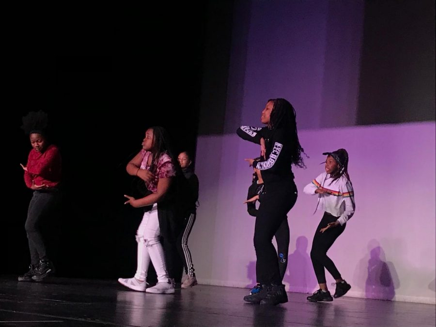 Team Swag, consisting of London Walker, Bryon Boyle, Ania Goodman, Isreal Lanos, and Tamia Williams dancing in unison.
