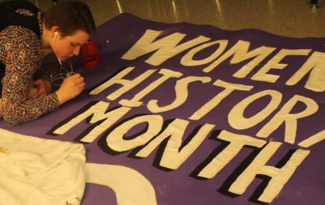 Sophomore Lilliana Bremerkamp works on a poster for the HERstory Museum in art teacher Caitlin Munguia's room.