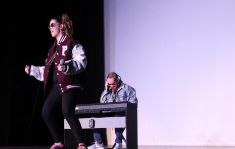 "At the lip sync battle in the Sun Theatre, visual art teacher Caitlin Munguia, math teacher Michael Mancuso and (offstage)  counselor Kim Campbell perform to the song 'Push It' by Salt-N-Peppa. ""I thought it would be a great way to have the kids see how silly I can be and that we're just people too. The interaction and comradery it builds. I got to know Ms. Muguia and Mr. Mancuso better so that's nice for me being new,"