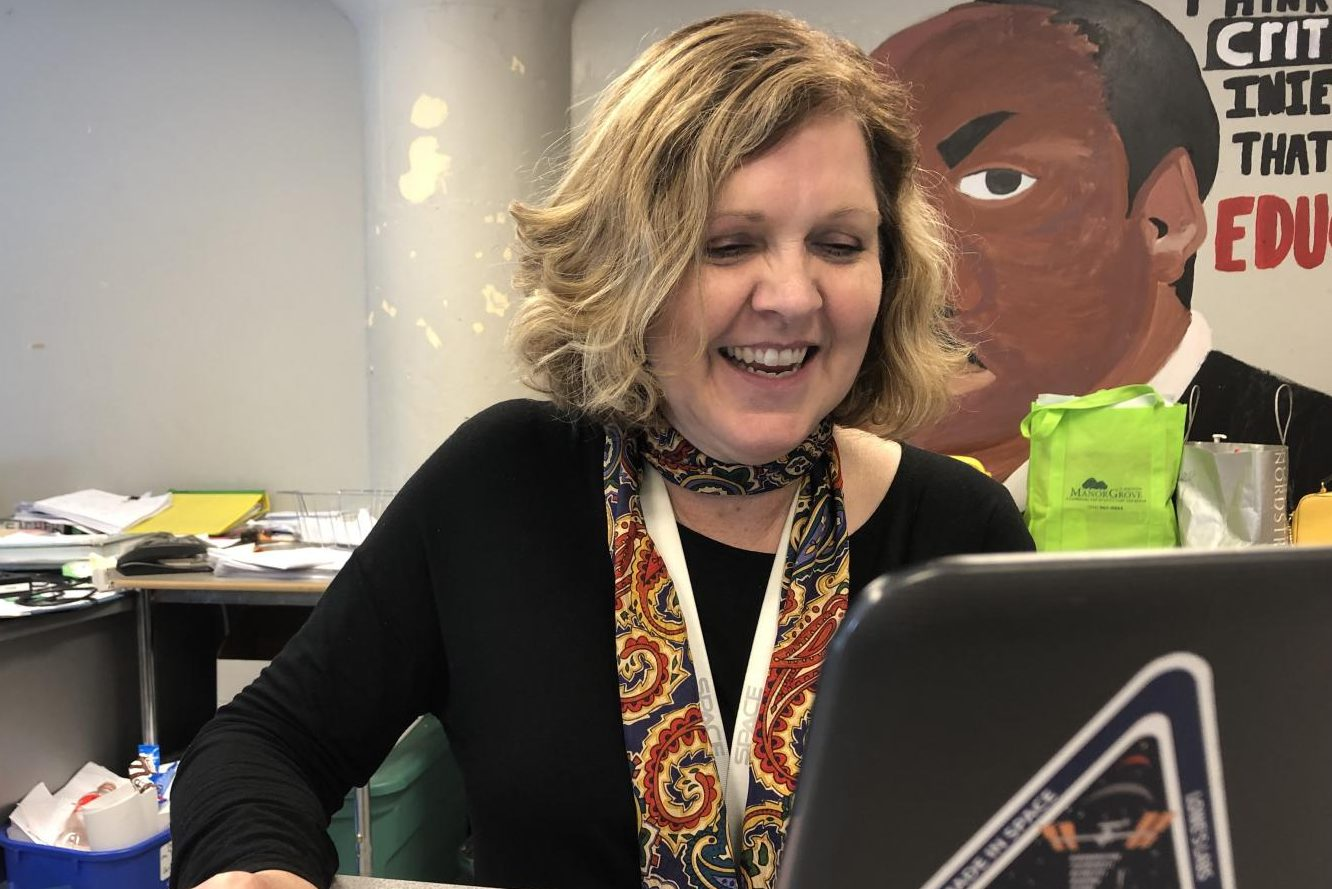 Christine Nobbe, gifted specialist, looking for scholarships opportunities and checking up on students grades.