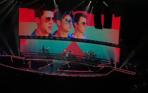 The Jonas Brothers performing their big hit,