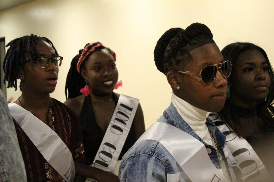 Inline for their introductions, seniors Lizzy Baker, Jardyn Williams, Jermaine Williams, and Nuri Broady, prepare themselves to find out who won Homecoming royalty. With four nominees in each category, a nominee for King walked with a nominee for Queen down an aisle to the DJ stand.