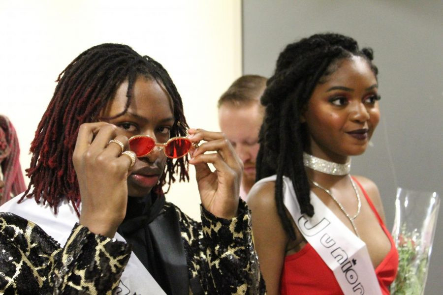 "Ready to walk down the aisle for Homecoming court junior prince Haile Emerson gives the camera a glance while junior princess Jakyah Overton smiles for the crowd. ""I ran for homecoming prince because freshman year I humiliated myself so I wanted to redeem myself, simply,"