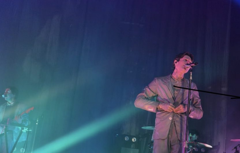 After an off-stage outfit change frontman, Jesse Rutherford, wears an all gray suit.
