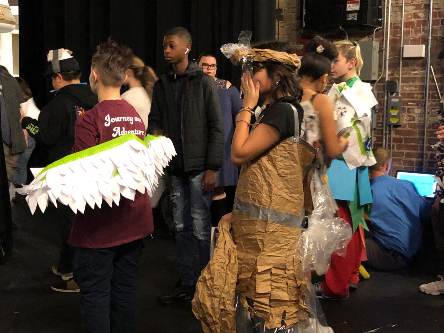 Pre-show rush, creators gather backstage to make their last alterations. Students practiced their runway walks and added to their outfits under the supervision of science teacher Cassandra Lentz and Makerspace teacher Josh Linn.