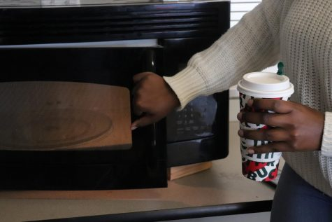 Microwaves are back and are in use! Senior Mya Wraggs heats up her coffee in the North cafeteria.