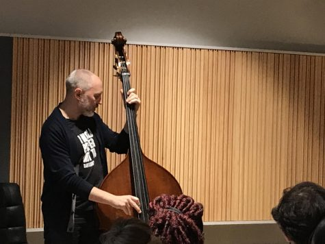 Jazz bassist Reid Anderson, playing along to,