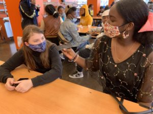 Editor Korissa Smith, senior (right), interviews 6th grader Isabella Meyer during lunch on Sept. 23, 2021.